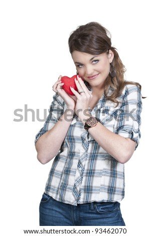 A beautiful young woman holding a Valentines Day heart - stock photo