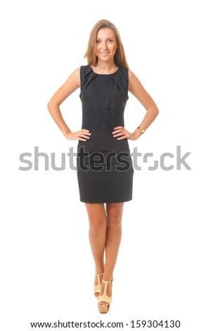 A beautiful young woman in a black dress isolated on white background. - stock photo