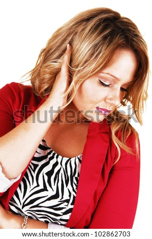 A beautiful young woman in a nice pose looking down with one hand on her head, in a red jacket for white background.