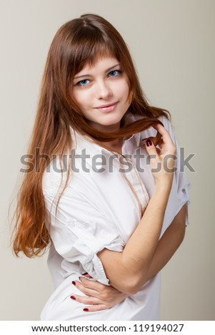 A beautiful young woman in a white shirt