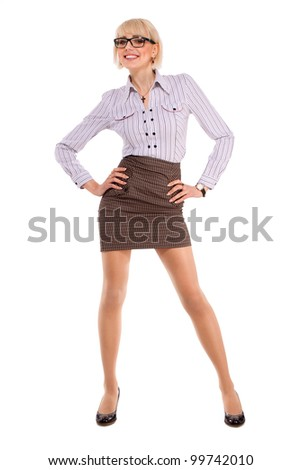a beautiful young woman in business attire on a white background - stock photo