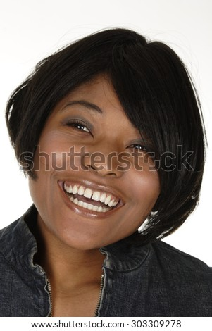 A beautiful young woman looks up laughing.