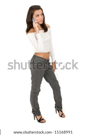 A beautiful young woman on the phone - stock photo