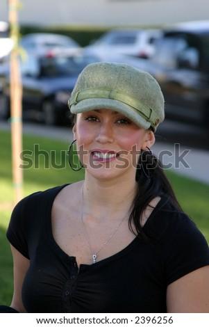 a beautiful young woman outside - stock photo