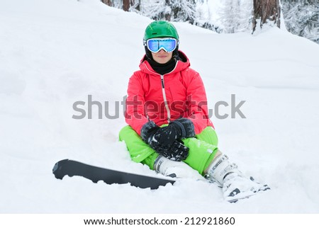 A beautiful young woman skiing in the Alps - stock photo