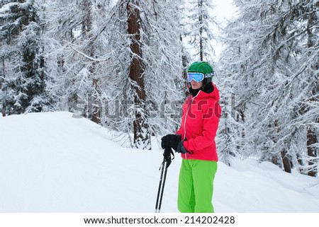 A beautiful young woman skiing in the Alps