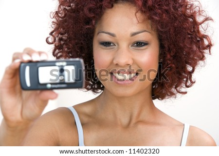 A beautiful young woman taking pictures with her cellphone