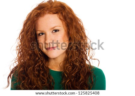 A beautiful young woman with naturally curly red hair and cute freckles.