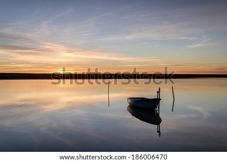 A beautifully calm winters day sunset on the Fleet Lagoon at Chesil Beach in Dorset. - stock photo