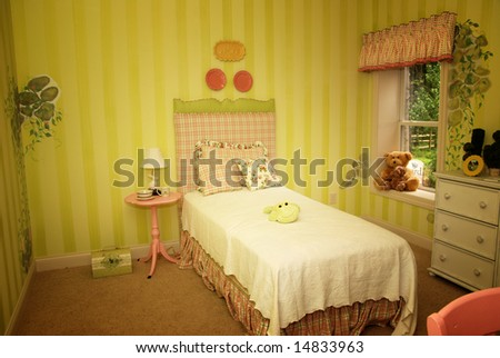 A beautifully decorated child's bedroom - stock photo