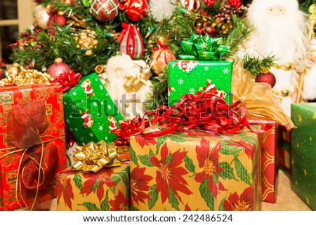 A beautifully decorated traditional Christmas tree with presents - stock photo