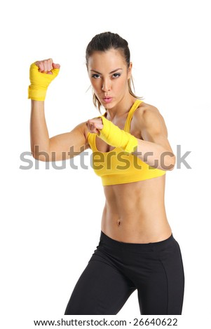 A beautuful young aerobics instructor isolated on a white background - stock photo