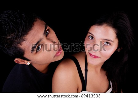 a beauty and cute couple looking up, isolated on black, studio shot - stock photo