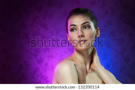 a beauty girl on the color background - stock photo
