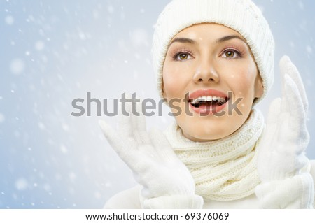 a beauty girl on the snow background - stock photo