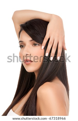 a beauty portrait of a young woman, shot on white background. she has long, dark brown hair; she looks away from th ecamera, while holding one arm over her head. - stock photo