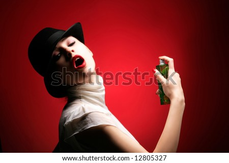 a beauty retro girl with parfum on red - stock photo