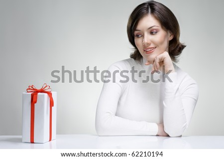 a beauty young girl with christmas gift - stock photo