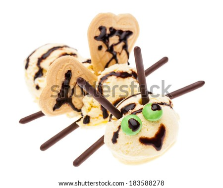A bee made of vanilla ice cream with eyes, wings and sensors - stock photo