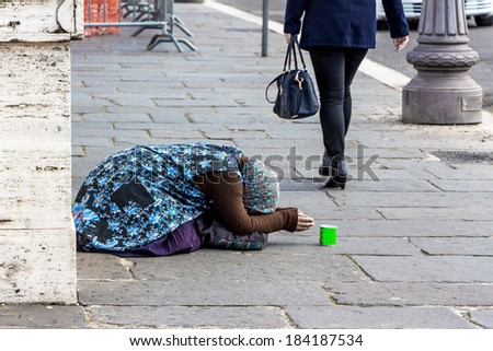 a beggar begging on a street in the - stock photo