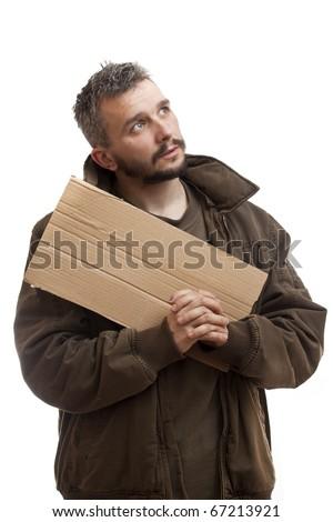 A beggar holding carton suitable for adding text and pray - stock photo