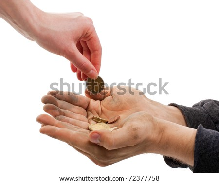 A beggar receiving money from a kind woman,isolated on white.
