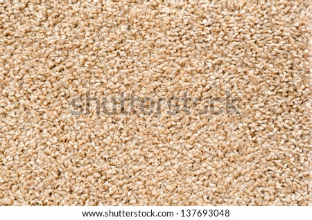 a beige thick artificial carpet, closeup shot - stock photo