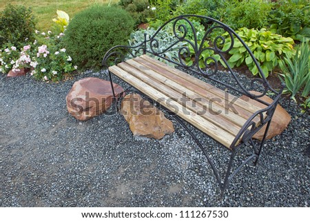 A bench in the garden - stock photo