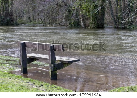 A bench surrounded by water as the River Itchen is in Flood - stock photo