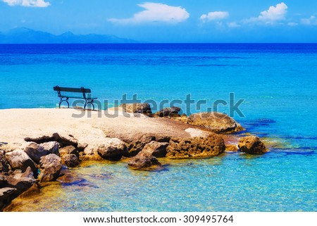 A bench with a view in Ammoudi village, Zakynthos island, Greece - stock photo