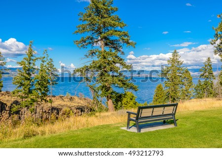 A bench with gorgeous view at mountain lake, British Columbia, Canada.