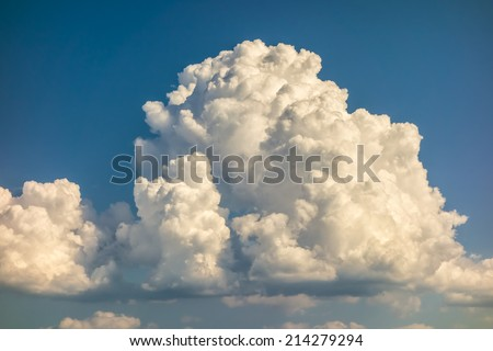 a big and fluffy cumulonimbus cloud in the blue sky - stock photo