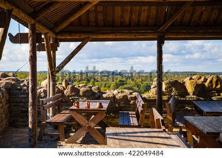 a big and old wooden tables in medieval castle of Rakvere - stock photo
