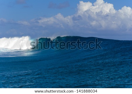 A big and powerful ocean wave breaking near the shore at Teahupoo on the Tahiti island, in French Polynesia - stock photo