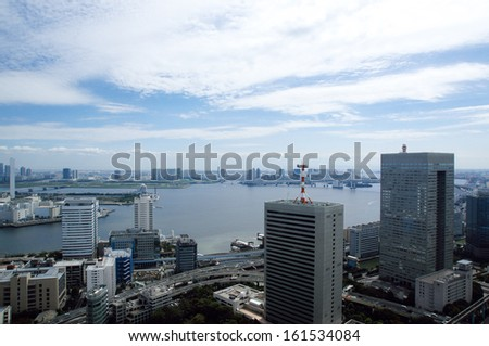 A big city with buildings around a river. - stock photo