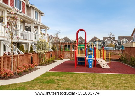 A big colorful children playground equipment in the apartment complex. - stock photo