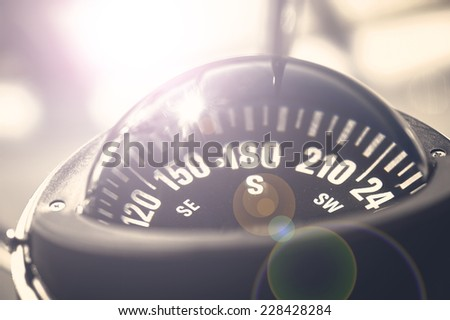 A big compass on a boat showing direction - stock photo