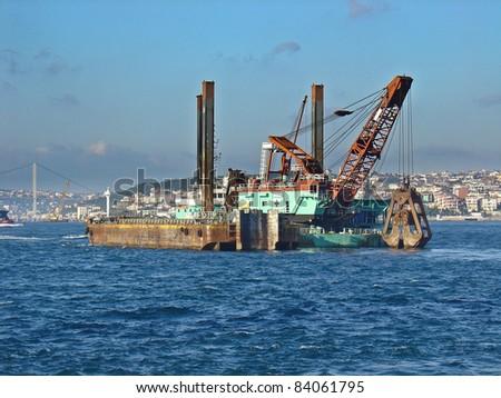 a big dredging boat in bosphorus - stock photo