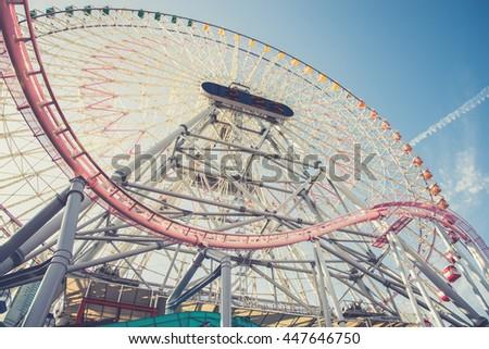 A big ferris wheel in Yokohama, Japan.(Vintage filter effect used) - stock photo