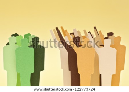 A big group on agreement against a smaller group of the same people. Majority / minority. Divided society. - stock photo
