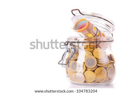 A big money jar full of savings - stock photo