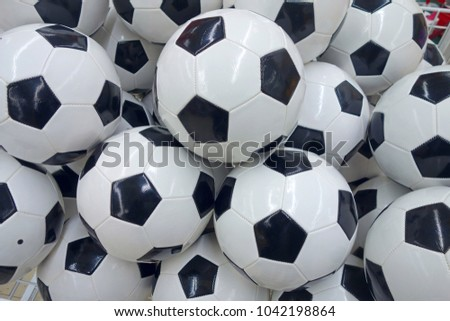 A big pile of new footballs. Sports background