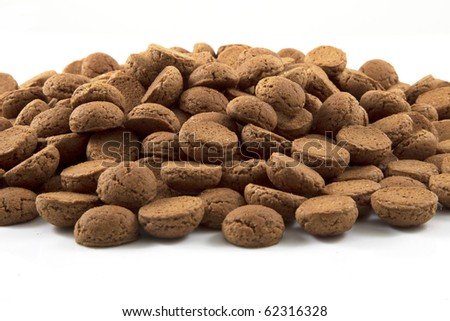A big pile of pepernoten on a white background.