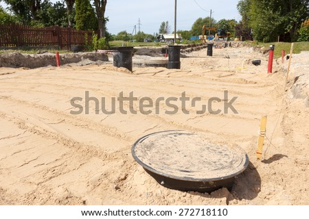 A big road construction site with equipment in the background - stock photo