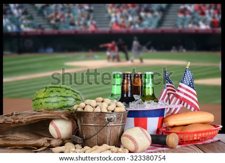 A big screen TV with a baseball game. In front of the television is a spread of snack food, beer and sports equipment. Great for Playoff or World Series themed projects. TV is out of focus. - stock photo