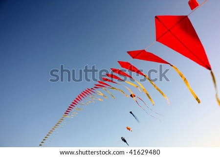 A big set of flying kites against the blue sky