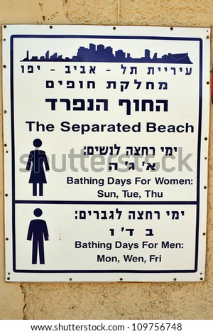 A big sign posted at the entrance of the religious beach in Tel-Aviv beach on the coastline of the Mediterranean sea. Israel.