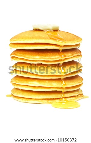 A big stack of pancakes with syrup and butter on focus. Shallow depth of field