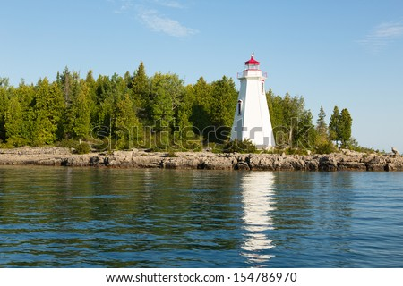 A Big Tub lighthouse in Tobermory, Ontario, Canada - stock photo