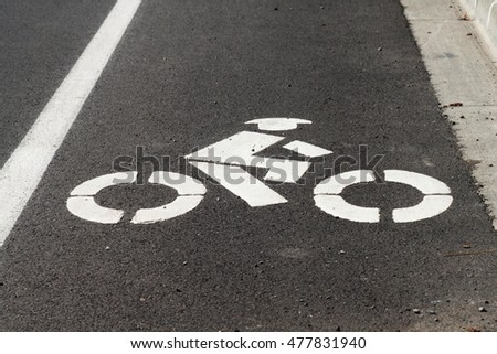 A bike lane stencil on a public road
